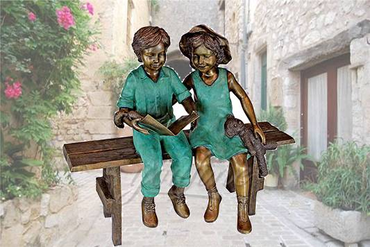 Life size outdoor sitting bronze children reading sculpture